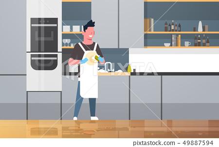 young man washing dishes guy wiping plates doing housework dishwashing concept modern kitchen 49887594