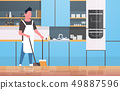 man sweeping floor with broom and scoop young guy doing housework house cleaning concept modern 49887596