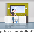man in gloves and apron cleaning mirror with squeegee guy doing housework concept modern bathroom 49887601