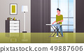 man ironing clothes guy holding iron doing housework housekeeping concept modern house living room 49887606
