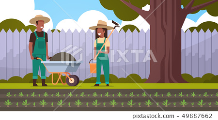 gardener man with wheelbarrow of earth woman holding hoe and bucket african american couple farmers 49887662