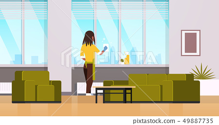 woman in gloves and apron cleaning windows with rag cleaner spray rear view african american 49887735