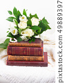 Old books with flowers 49889397