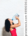 Thirsty Young Woman Drinking Water From Plastic Bottle For Health 49900361