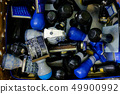 Many rubber stamps are put together in a basket. 49900992