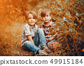 Cute little boys playing in a park 49915184