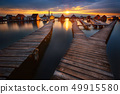Sunset over lake Bokod with wooden pier and floating houses, Hungary 49915580