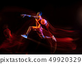 Young basketball player against dark background 49920329