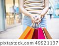 Asian Woman Holding Shopping Bags 49921137