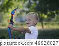 A little boy and a toy bow 49928027