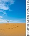 Explorer hiking on a desert 49933345