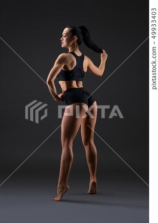 Tanned brunette doing fitness rearview 49933403