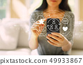 Social media with woman using a smartphone 49933867