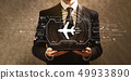 Airplane travel theme with businessman 49933890