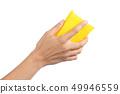 Woman hand holding a scourer 49946559