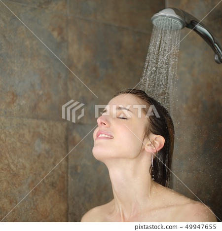 Relaxed woman showering in a shower 49947655