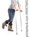 Close up of a woman walking with crutches 49947665