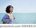 Asian traveling backpacker breathing fresh air. 49948919