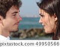 Close up of a couple looking each other with love 49950566