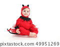 Baby with a red demon disguise 49951269
