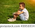 Ten years Old Child Keeps Broken Arm in Gypsum 49956934