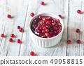 Bowl of cranberry sauce 49958815