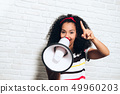 Girl Shouting Screaming Yelling With Megaphone For Promotion Advertising 49960203
