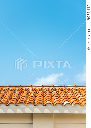 Blue sky and Okinawa red tiled roof 49971413