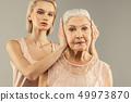 daughter, mother, elderly 49973870