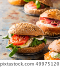 Italian Caprese sandwiches with fresh tomatoes, mozzarella cheese 49975120