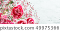 Bouquet of pink carnation on light turquoise wooden background 49975366