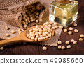 Soybean oil on a wooden background. rustic style 49985660