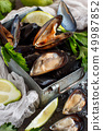 Fresh uncooked  mussels 49987852