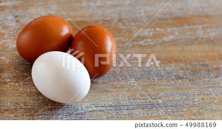 Chicken eggs close up 49988169