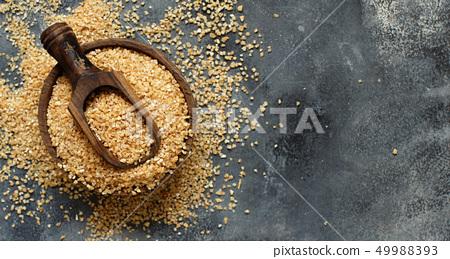Dry bulgur wheat grains 49988393
