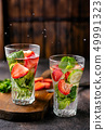 Two glasses with infused water on rustic background 49991323