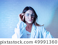 Portrait of beautiful female scientist in neon light 49991360