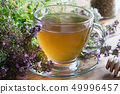 A cup of Breckland thyme (thymus serpyllum) tea 49996457