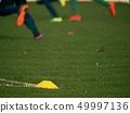 Yellow training cone. Soccer training equipment  49997136