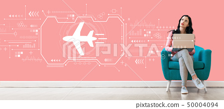 Airplane travel theme with woman using a laptop 50004094