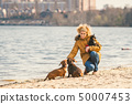 Subject lot pets, dog lover on walk. Adult, old elderly Caucasian woman with three dogs breed 50007453