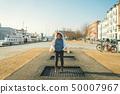 adult person rejoices like child. Playground trampoline in ground, children trampoline, springs 50007967