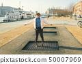 adult person rejoices like child. Playground trampoline in ground, children trampoline, springs 50007969