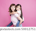 happy beautiful mother playing her child 50012751