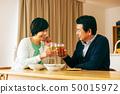 Couple supper liquor alcohol toast 50015972
