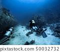 Scuba diver descending to the bottom 50032732