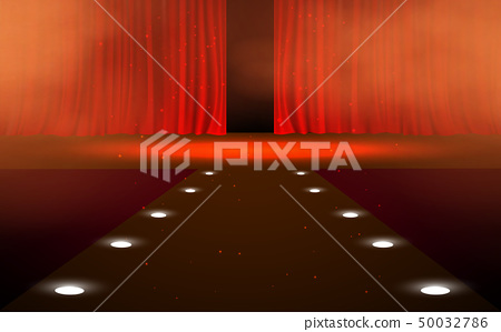 Red curtain with spotlight on the stage 50032786