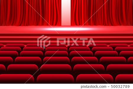 Red curtain with spotlight on the stage 50032789