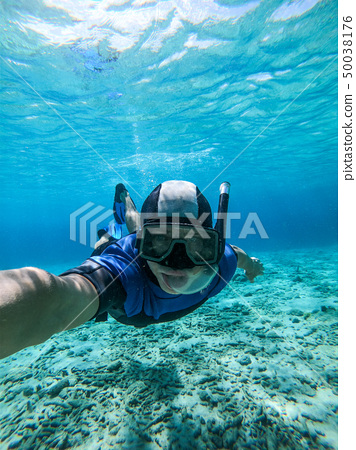 Freediver young man taking selfie portrait underwater 50038176