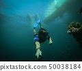 Free diver taking selfie with sunken ship on background 50038184